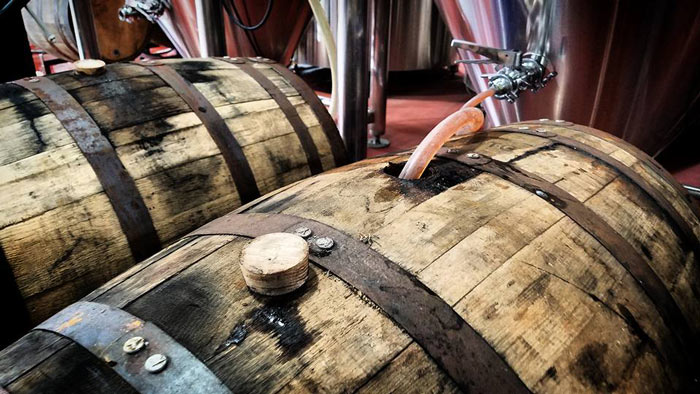 Barrels being filled with beer